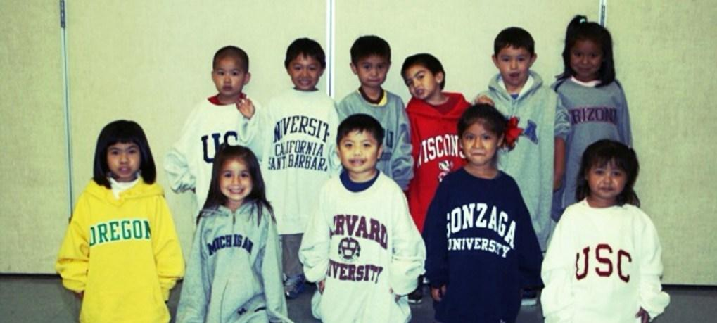Twelve preschoolers wearing college sweatshirts.