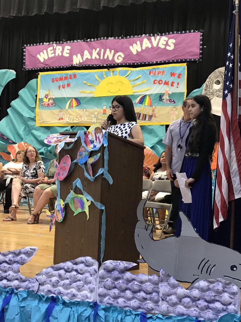 female 5th grade student at the podium