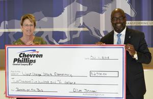 Chevron donates $2500 to Books on the Bus