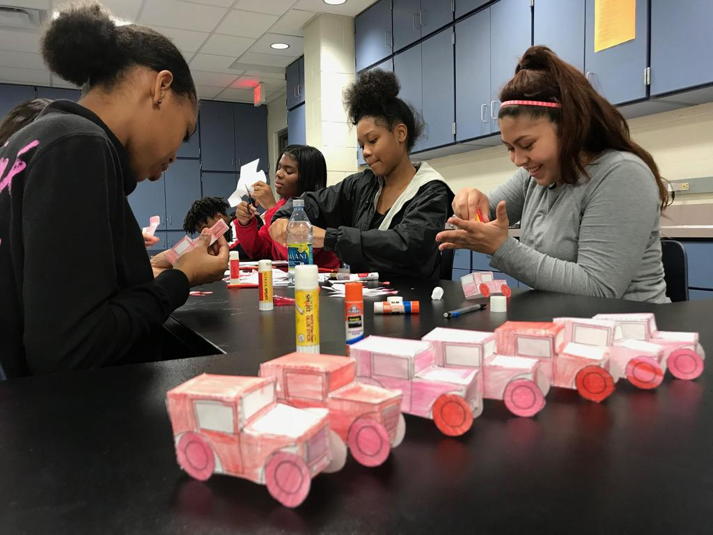 History students learn the ins and outs of the assembly line process as they engage in mass production of automobiles
