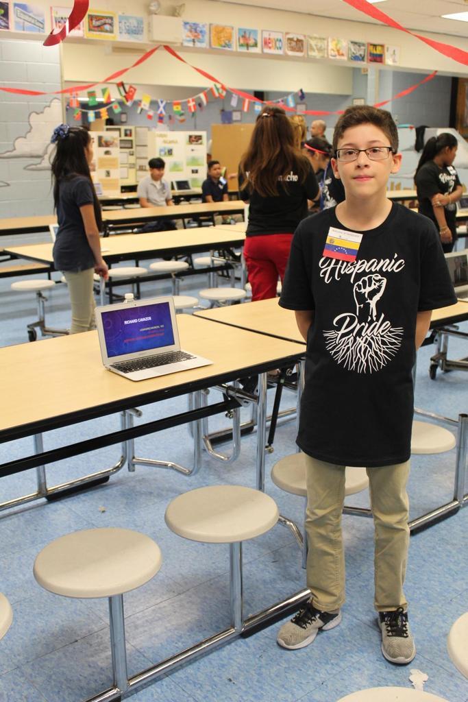 boy with presentation on richard cayazos
