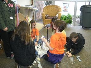 EBOB students work on MakerSpace activity and create chew toys for pets.