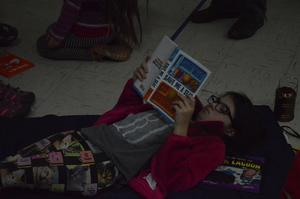 Student reading in the gym.