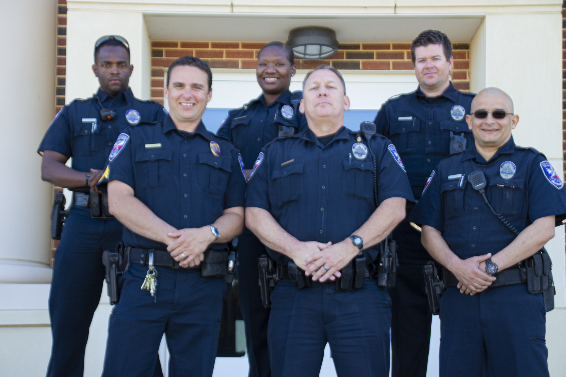 6 officers in uniform