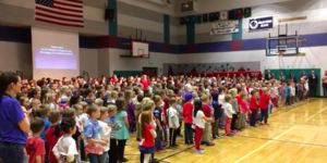 Brentwood students singing in the gym at our Veterans Day assembly.