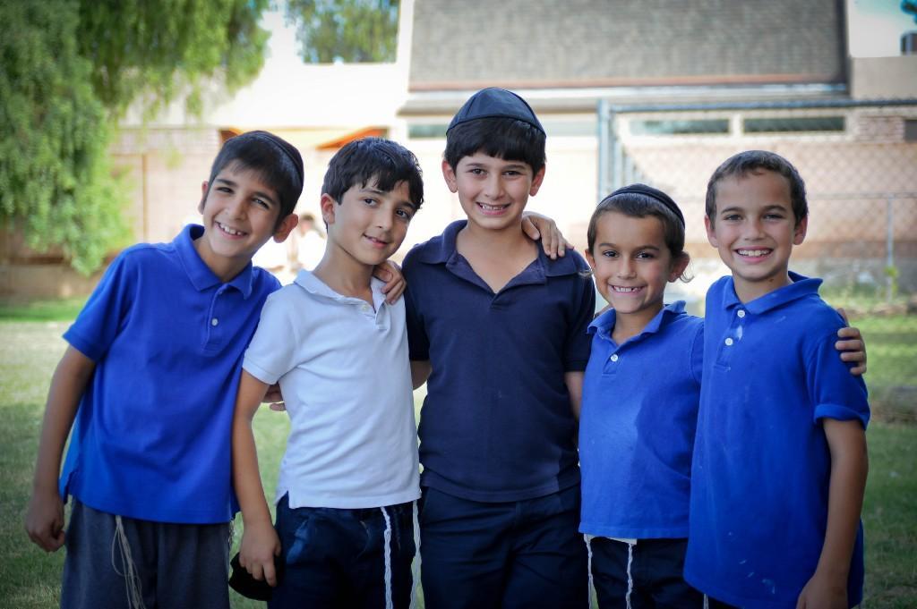 boys smiling outside