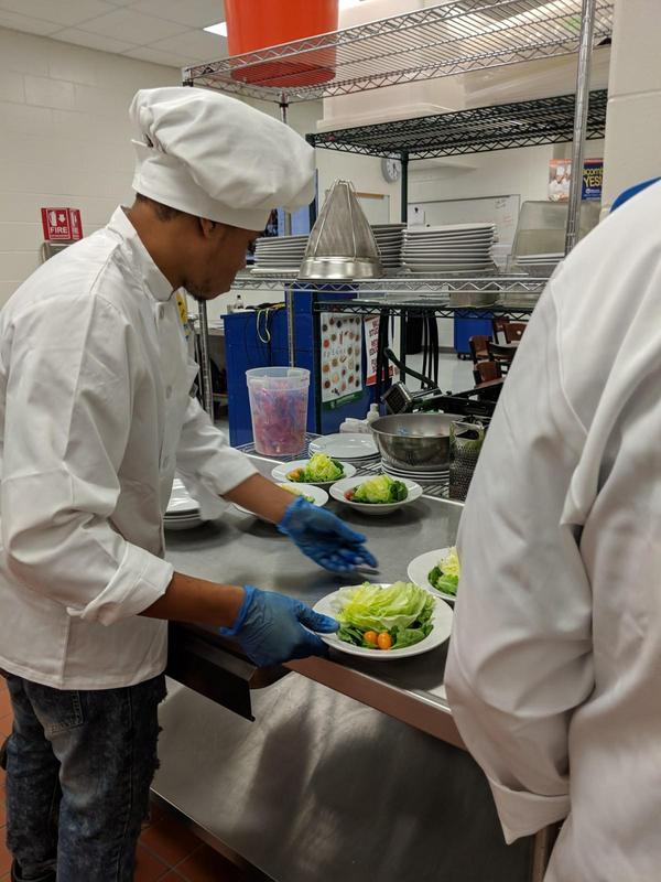 Student chef making salads