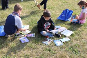 students sat outside to look at their books