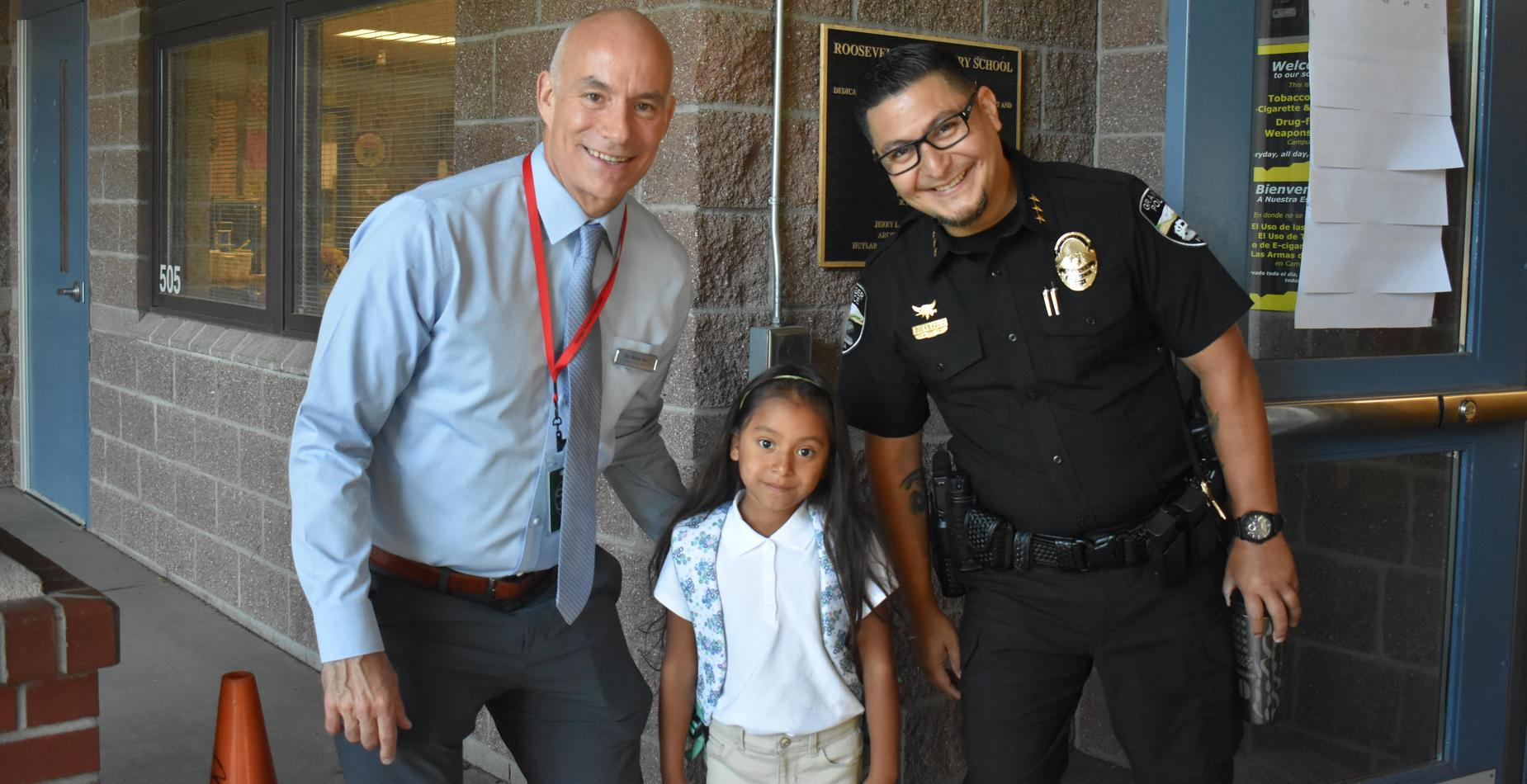 Our superintendent, RTO officer, and a first grade girl on the first day of school.