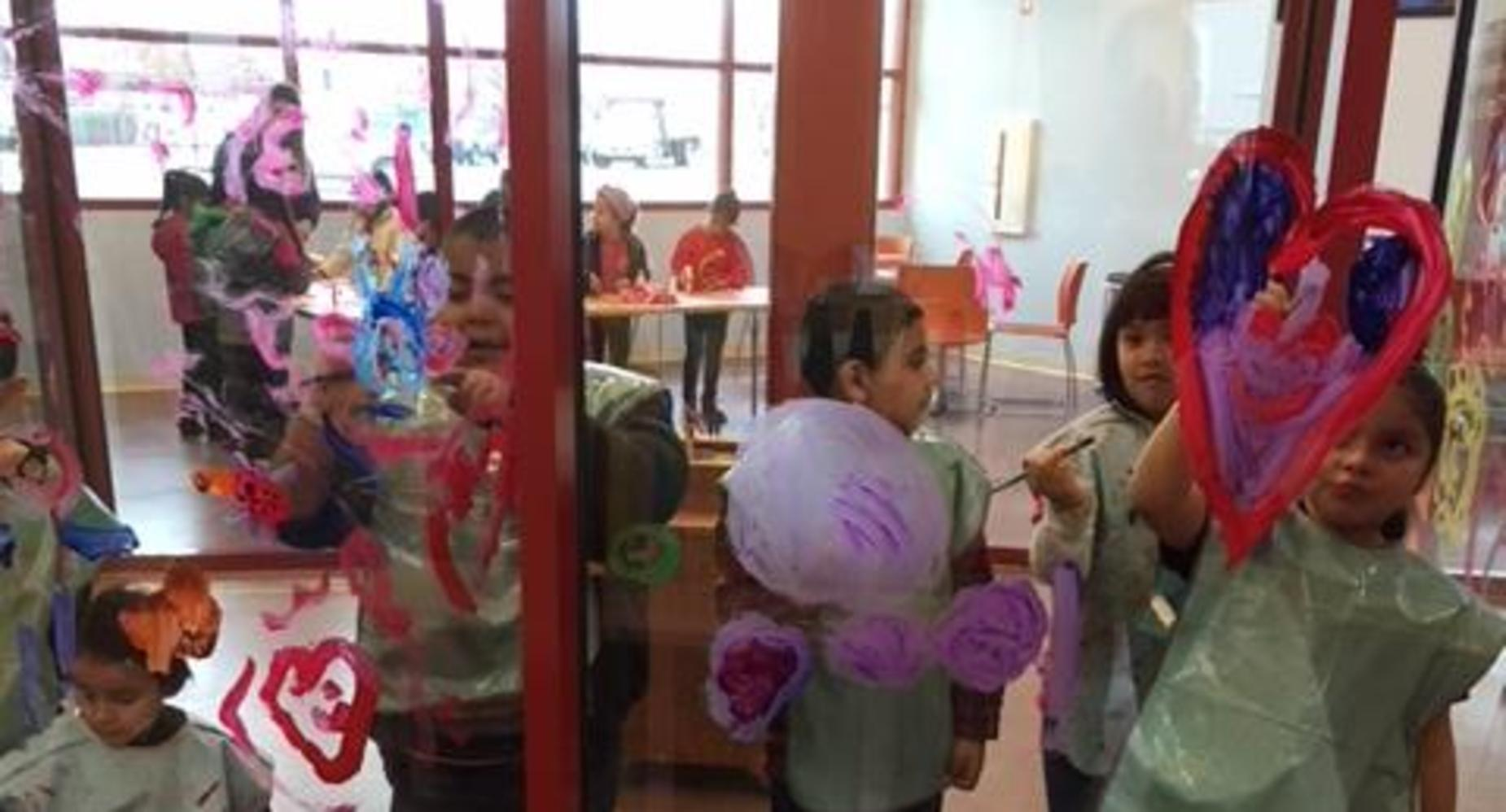 Cypress students creating window art at the Tulare Public Library