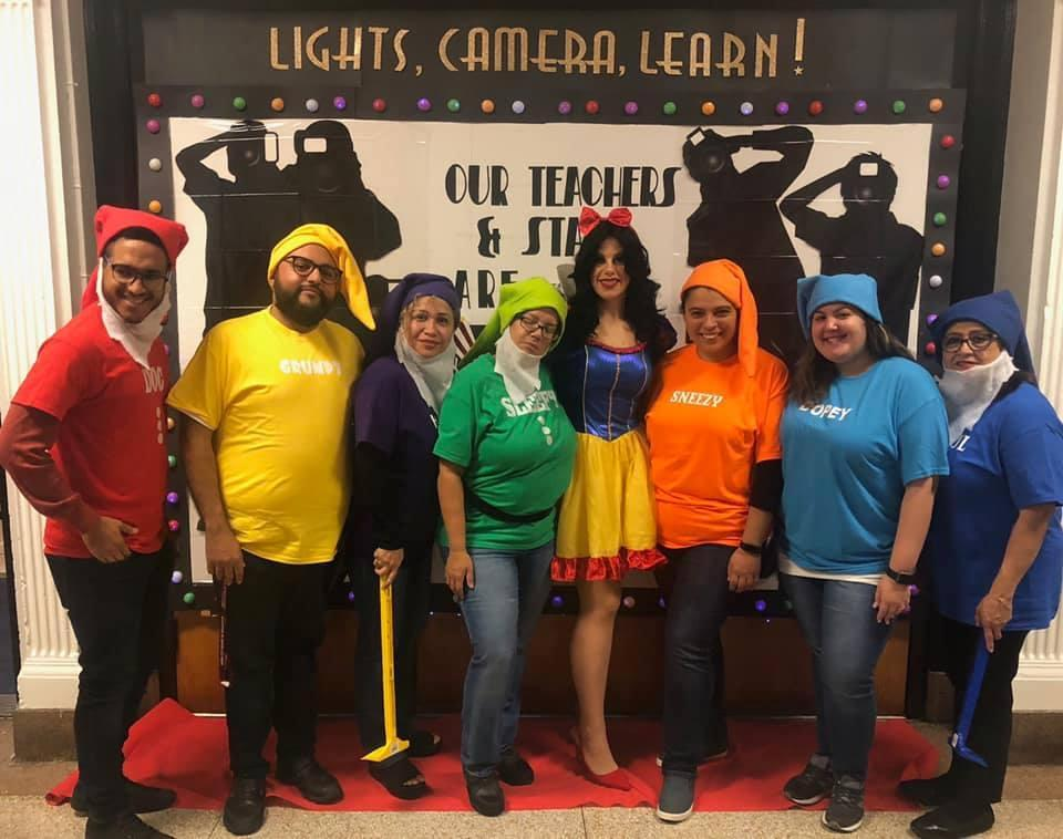 group of teachers as Snow White and her dwarfs