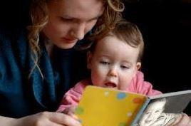 MOTHER READING TO BOY