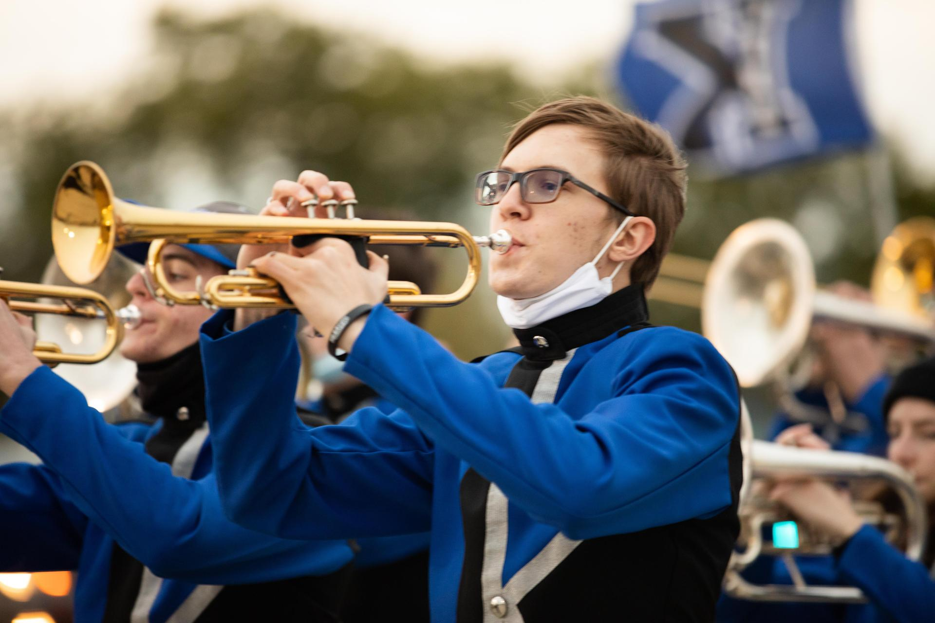 close up of musician playing the trumpet in the marching band