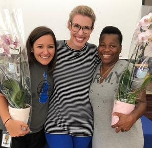 Fulmer Middle Principal Megan Carrero, center, poses with Teacher of the Year Leighton Harris, left, and Support Staff of the Year Marvell Mendenhall pose at the school after the awards announcement.