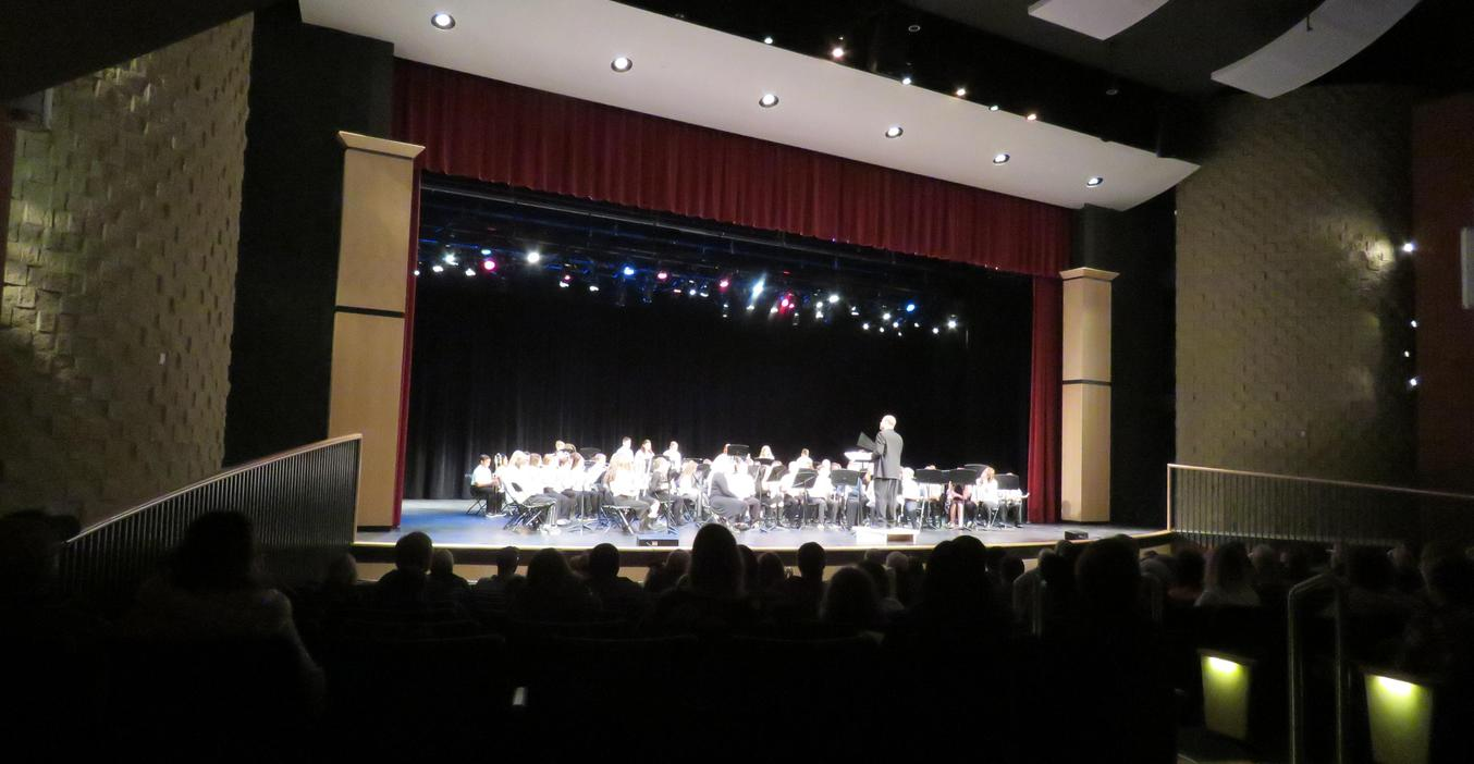 TKMS students perform in the high school auditorium.