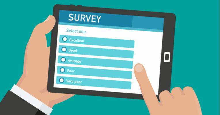 Image of a computer tablet with a survey, held by hands