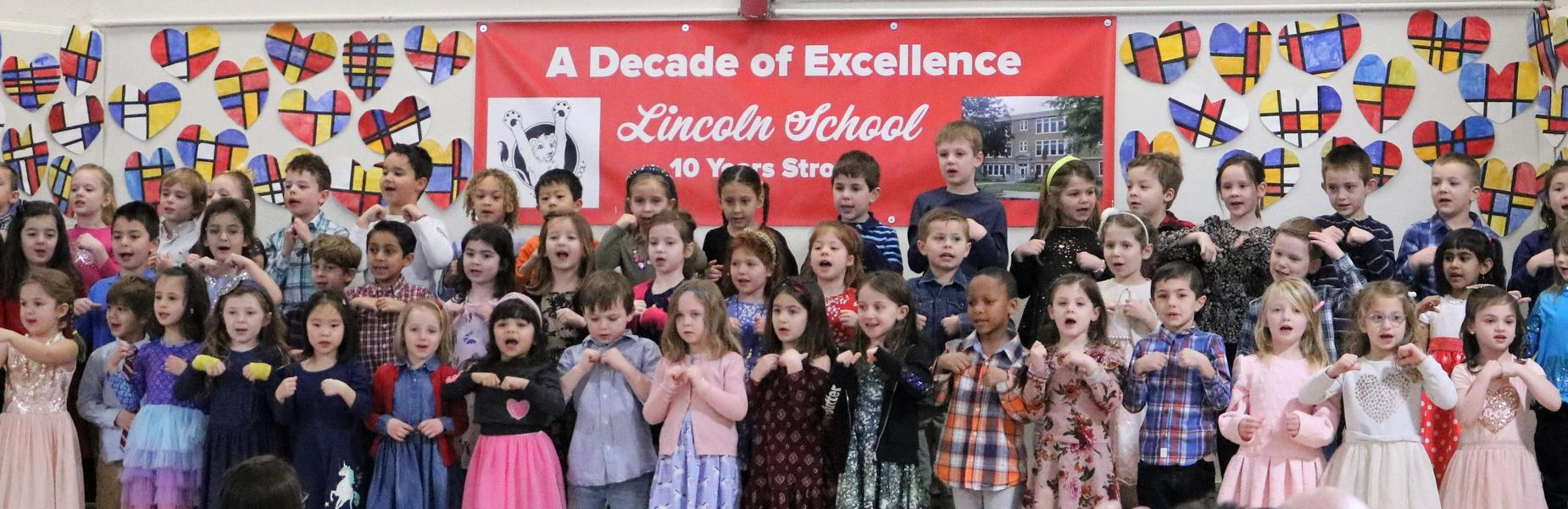 Photo of Lincoln School kindergartners singing on Grandparents Day.