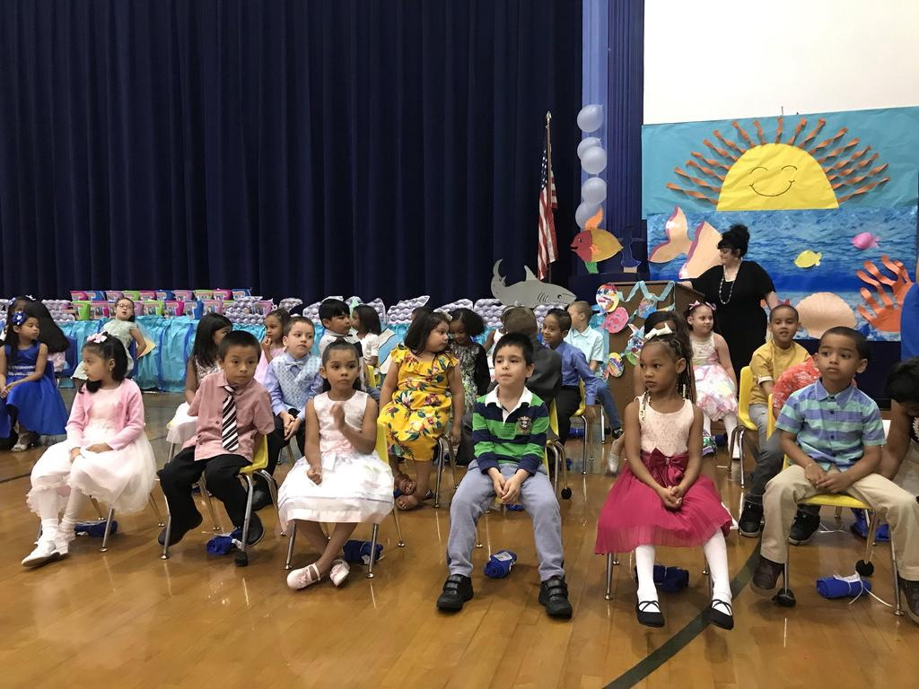 kindergartners sitting in the seats in front of the audience