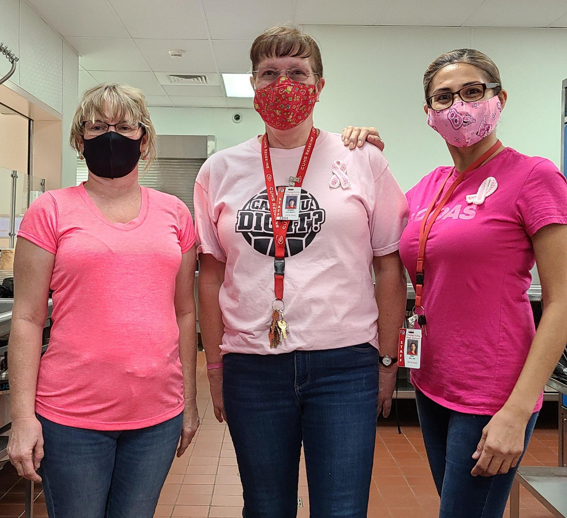 cafeteria staff wearing pink