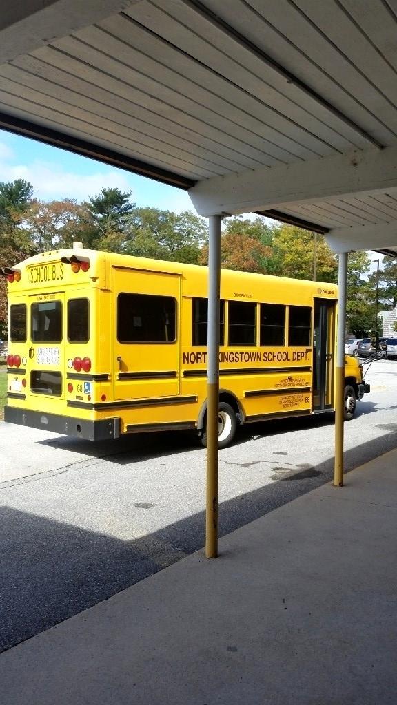 NK School Bus at front of school