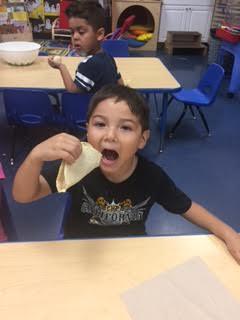 Student eating torilla.