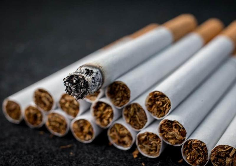 Photo of a black background and cigarettes