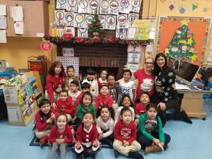 1st grade class showing off their christmas sweaters