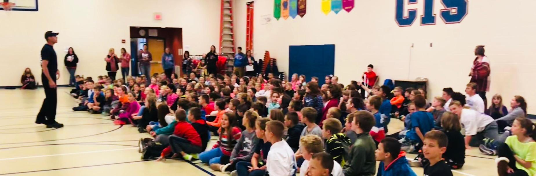 Students listen to fireman at assembly