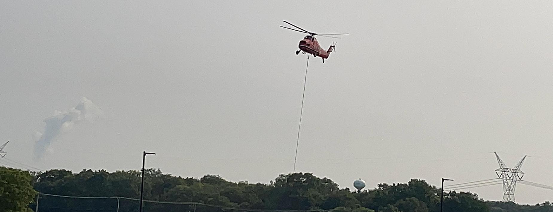 Helicopter placing the new HVAC -CCHS