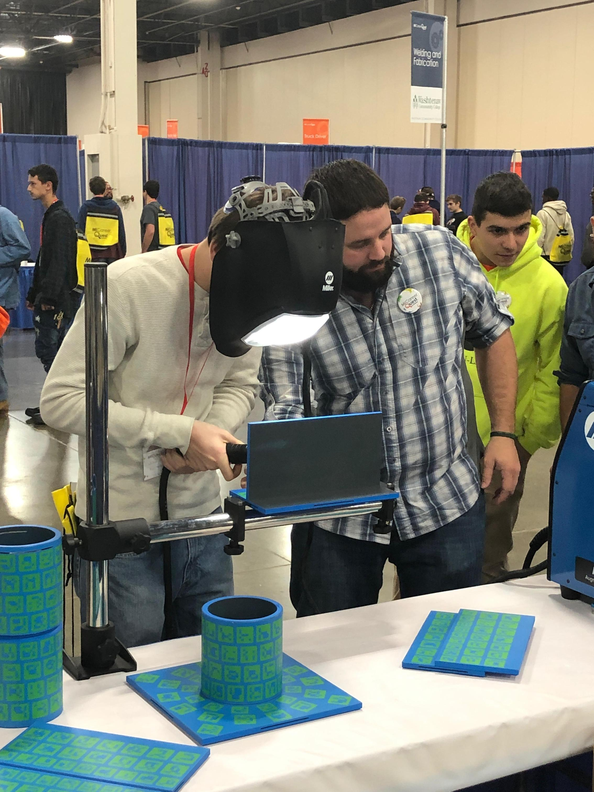 Student using a virtual welder
