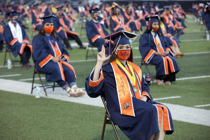 Economedes High School graduates attend their commencement ceremony at the Richard R. Flores Stadium in Edinburg.