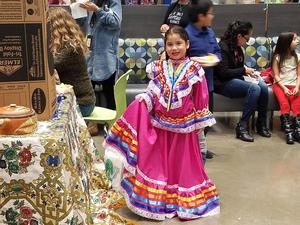 Young girl in bright pink Hispanic dress