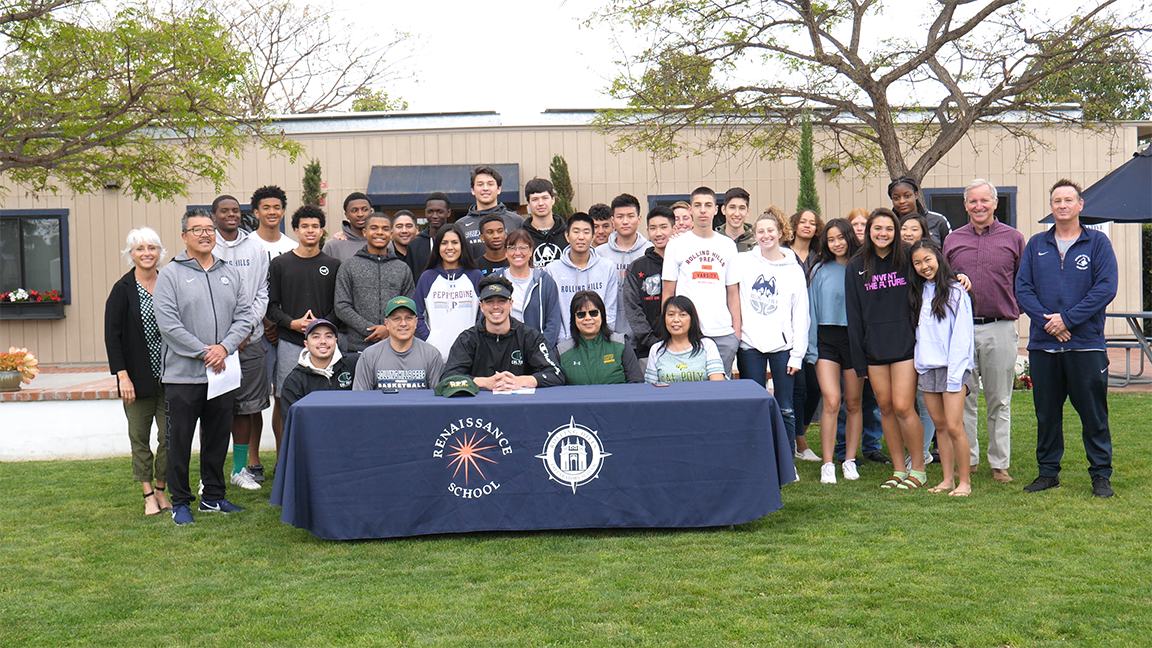 Chris K., varsity basketball player and Wooden Award winner, signing with a full athletic scholarship with Cal Poly Pomona.