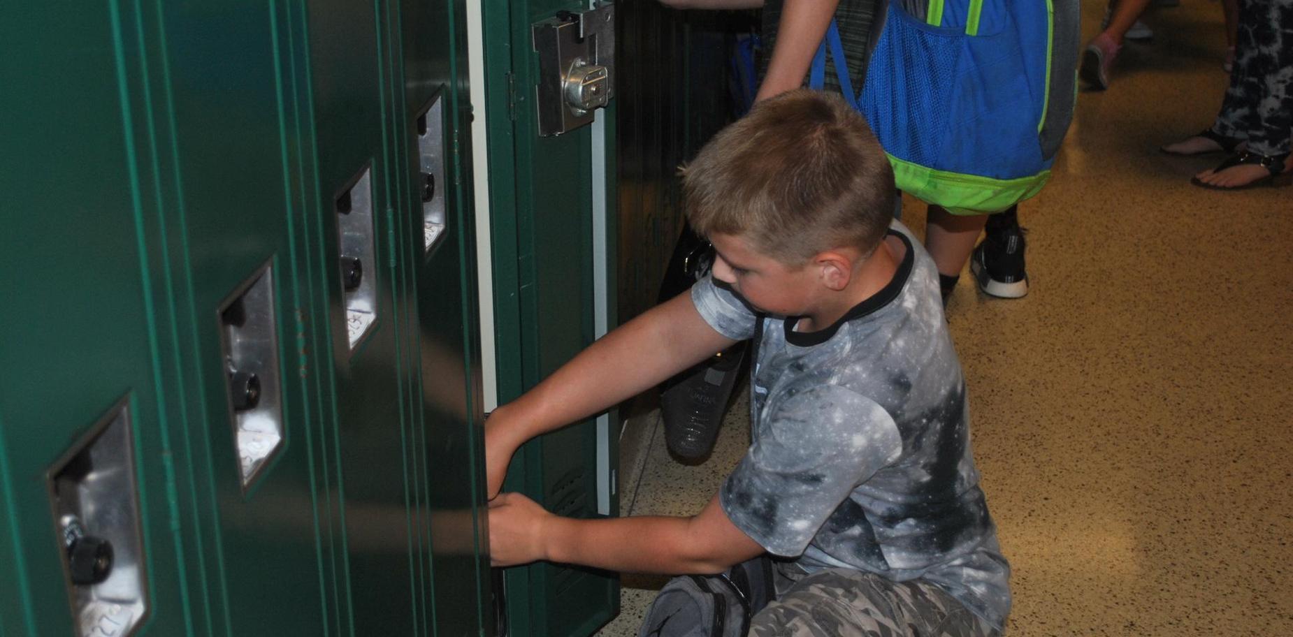KMS Student at locker