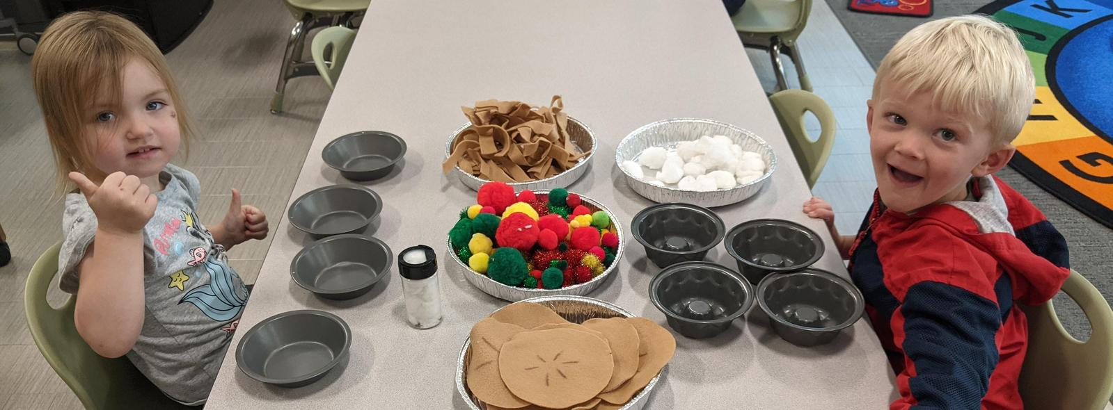 students making a pie with fabric pieces