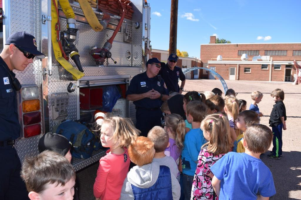 Firemen showing fire truck and how it works