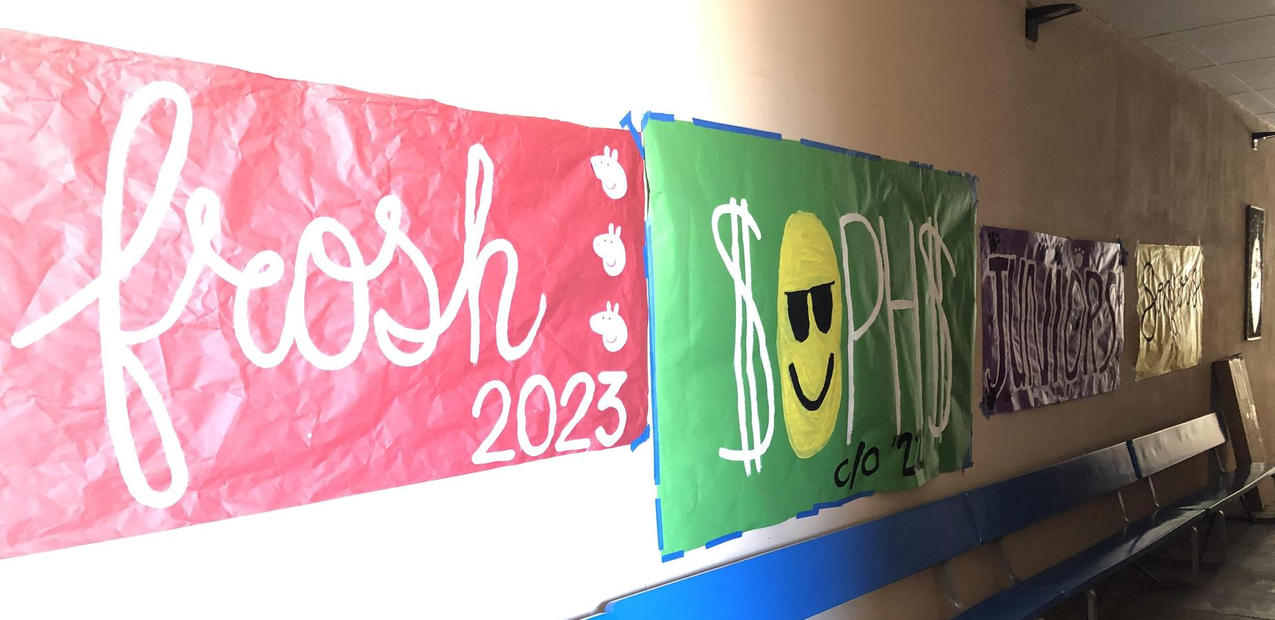 four class banners hung on a hallway