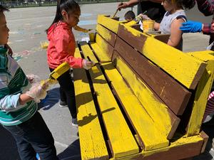 buddy bench being painted