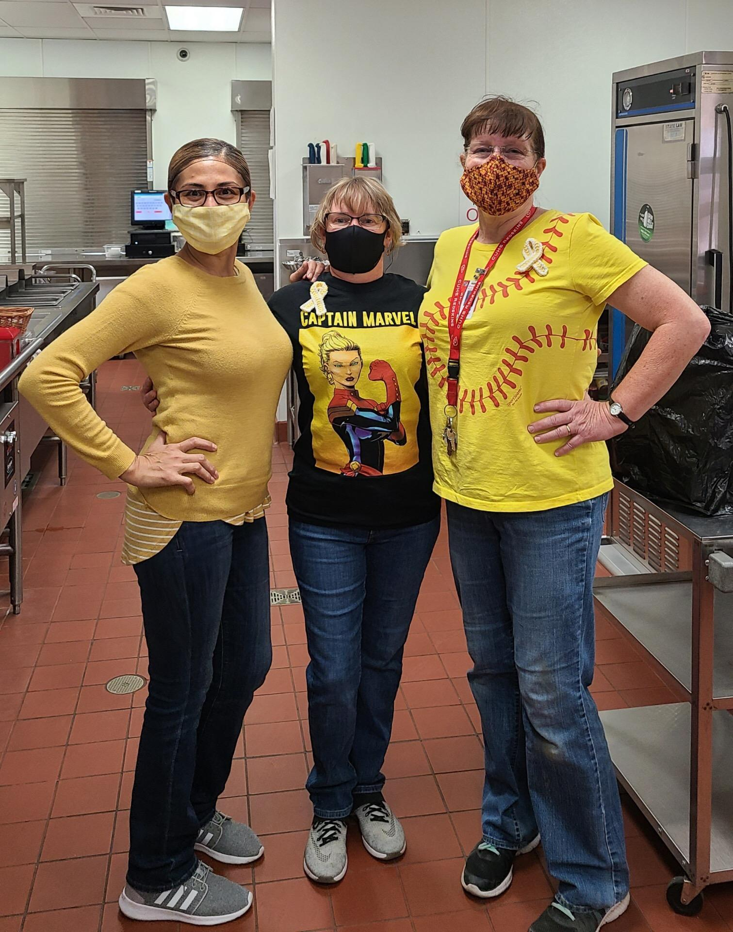 Cafeteria Staff wearing yellow
