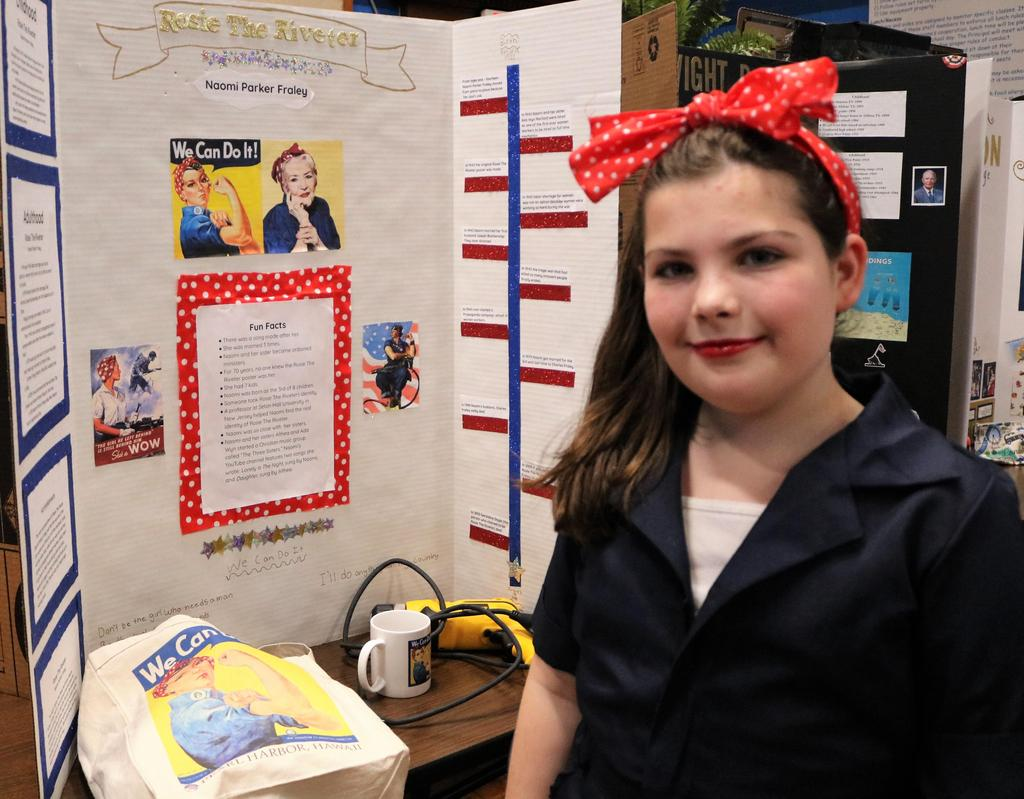 "Photo of Wilson 5th grader as Rosie the Riveter at annual ""Wax Museum"" event."