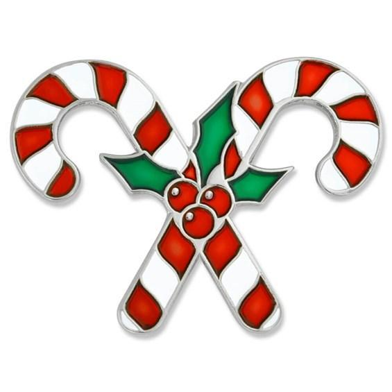 Two candy canes cross with holly in the middle