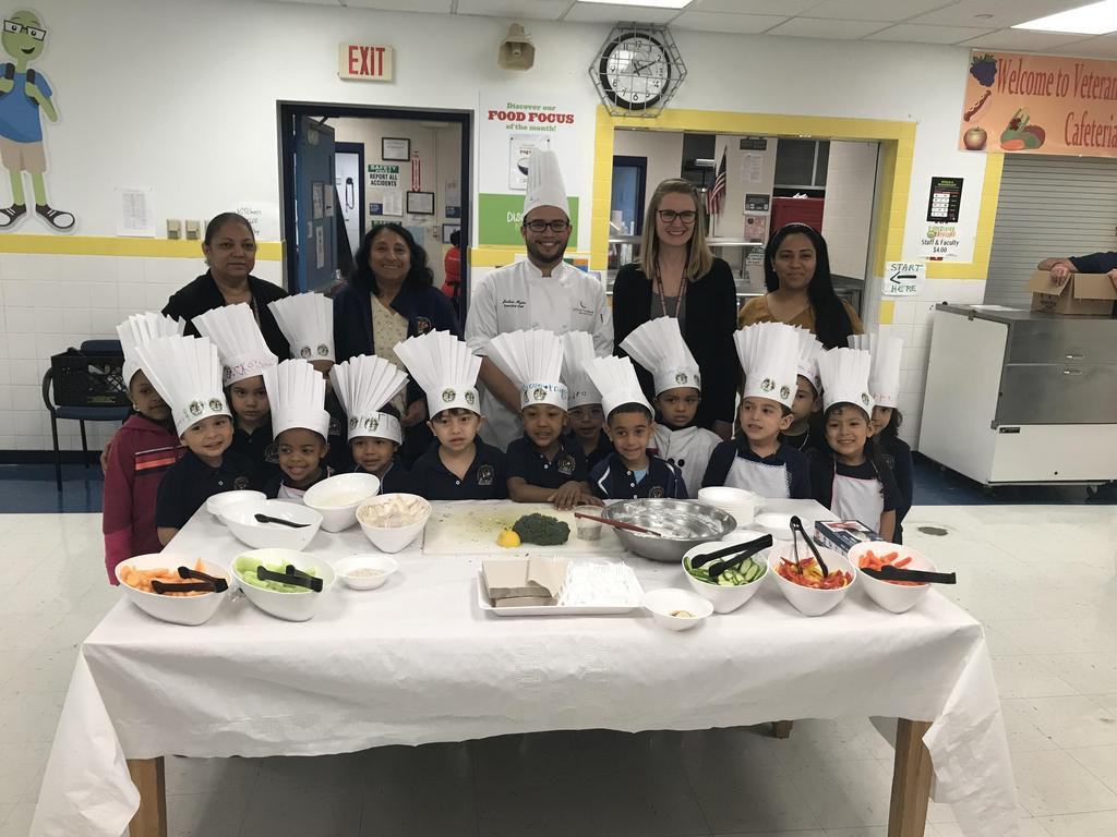 group photo of the pre-K, their teacher aides, Ms. Henderson and Chef Josh