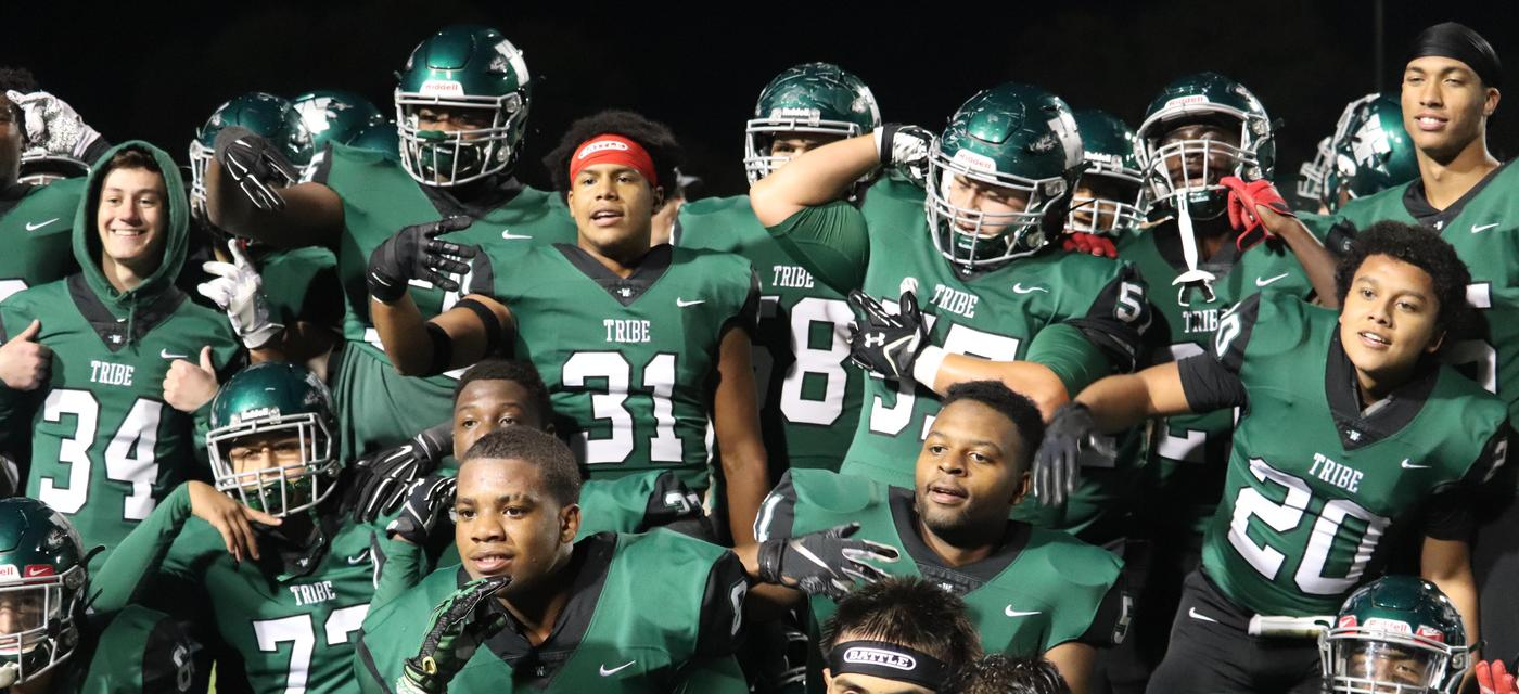 Varsity football players posing post-game
