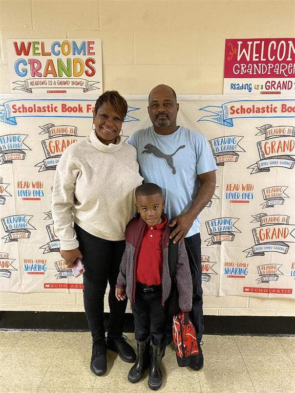 Photo of PRAMS dads and kids during scholastic's 2020 Spring Book Fair - Granola with Grandparents