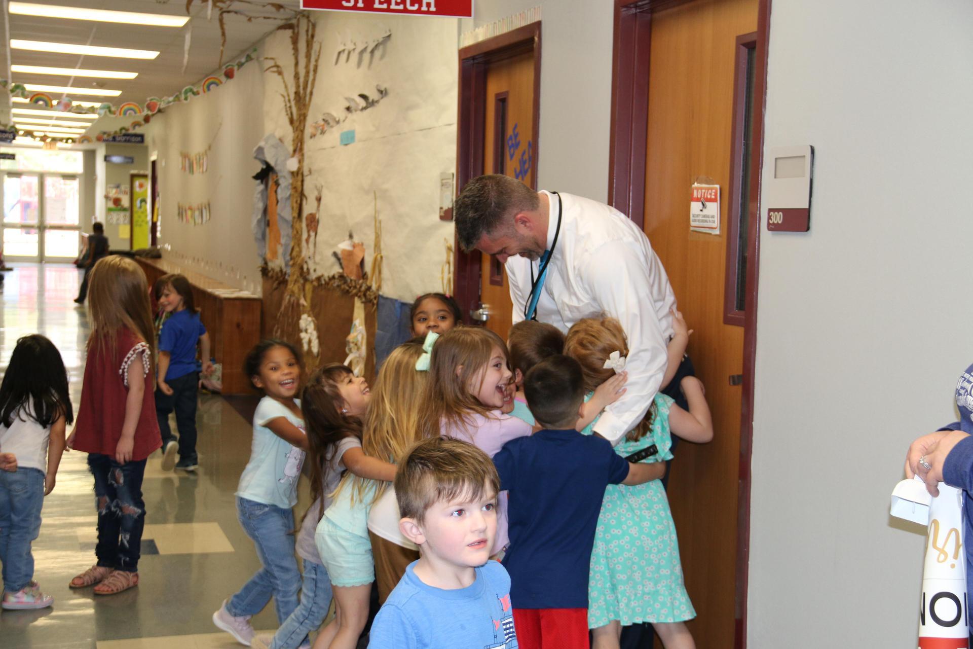 Bear Branch Elementary students embrace their principal, Jim Gassaway