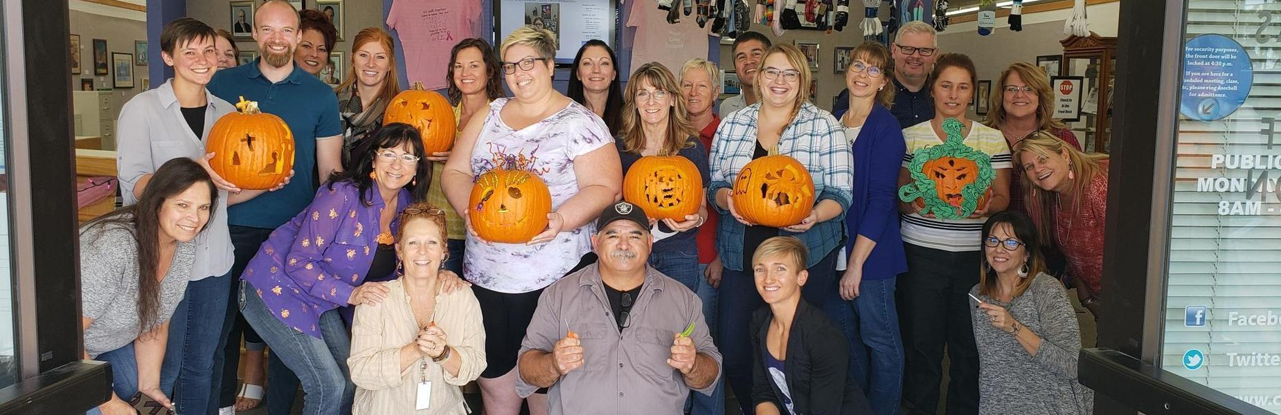 CCOE staff and carved pumpkins