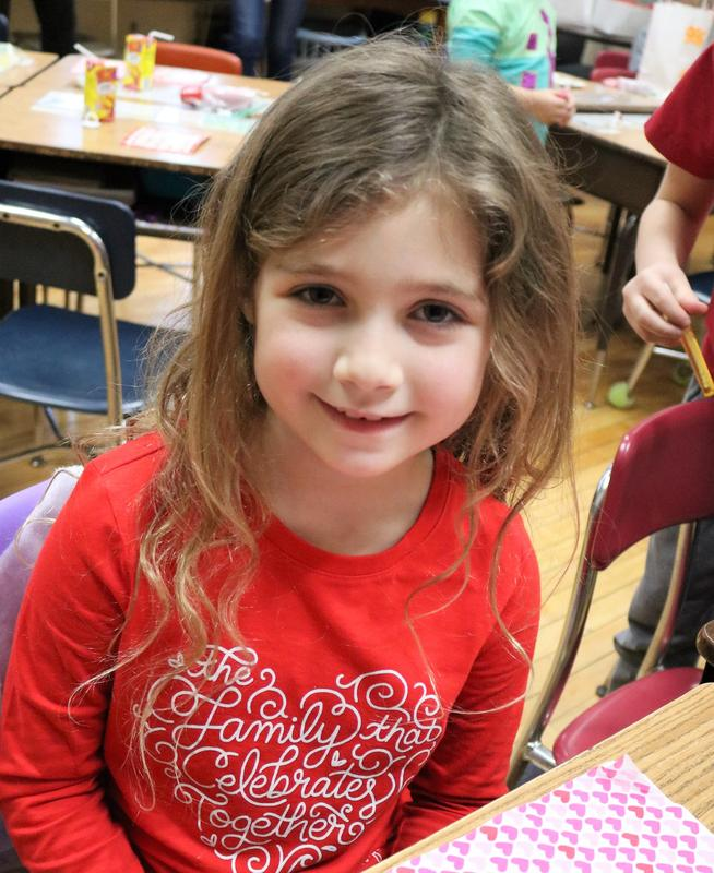 Photo of a student at McKinley School enjoying Valentine's Day activities.