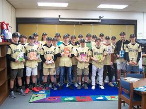 East Davidson High School baseball players holding Dr. Seuss books.