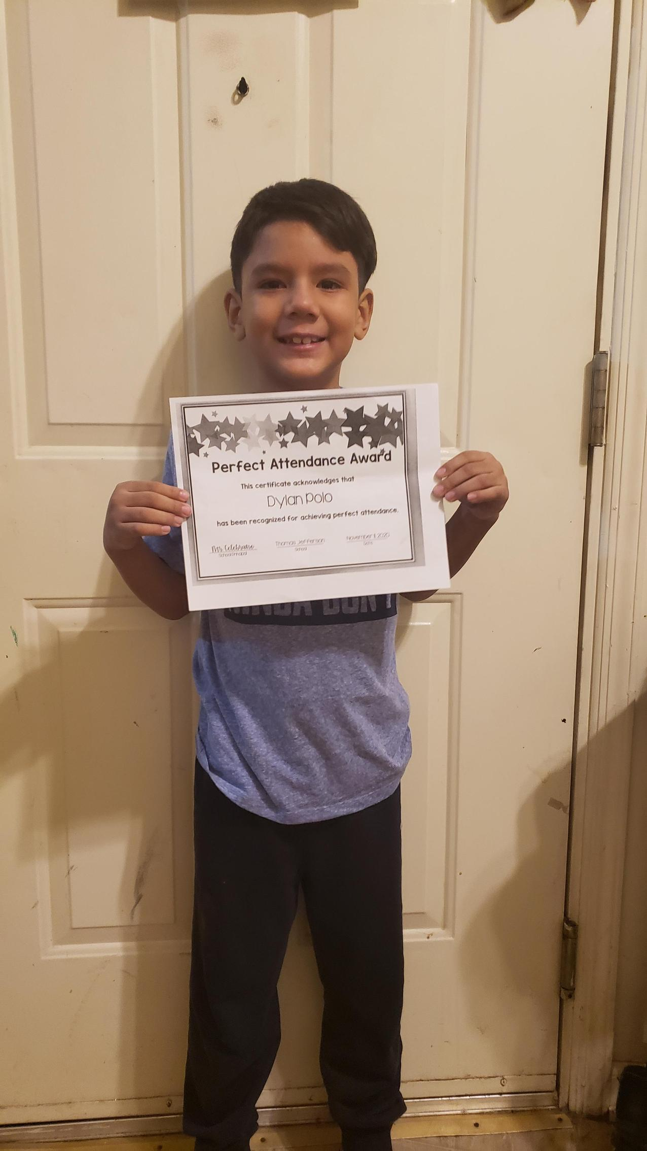Dylan Polo holding perfect attendance certificate