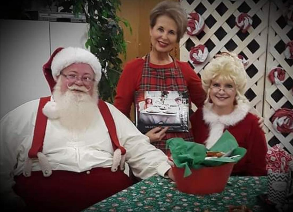 photo of mr. and mrs. claus with ms. jones during christmas culinary camp